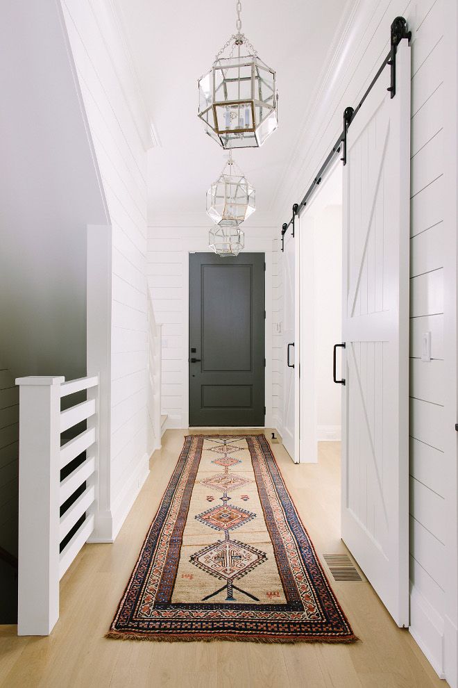 Farmhouse Hallway with bleached hardwood floors, shiplap paneling, vintage kilim runner, grey interior door and Visual Comfort Suzanne Kasler Morris Lantern Light Fixtures. Farmhouse Hallway with bleached hardwood floors, shiplap paneling, grey interior door and Visual Comfort Suzanne Kasler Morris Lantern Light Fixtures. Farmhouse Hallway with bleached hardwood floors, shiplap paneling, grey interior door and Visual Comfort Suzanne Kasler Morris Lantern Light Fixtures #Farmhouse #Hallway #bleachedhardwood #bleachedhardwoodfloors #shiplap #paneling #greyinteriordoor #greydoor #VisualComfort #SuzanneKasler #Morris #Lantern #LightFixtures #vintagekilimrunner #vintagerunner #kilimrunner Kate Marker Interiors