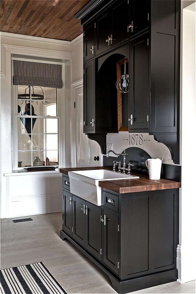 Farmhouse black kitchen cabinet with walnut butchers block countertop and farmhouse sink. Farmhouse black kitchen cabinet with walnut butchers block countertop and farmhouse sink. Farmhouse black kitchen cabinet with walnut butchers block countertop and farmhouse sink #Farmhousekitchen #blackkitchen #blackkitchencabinet #walnutbutchersblock #countertop #farmhouse #farmhousesink Home Bunch's Beautiful Homes of Instagram Cynthia Weber Design @Cynthia_Weber_Design