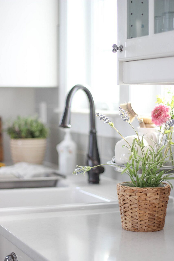 Farmhouse kitchen faucet Kohler Faucet. Faucet is Kohler. The countertop is Caesarstone in Organic White. #faucet #koh;er #farmhousefaucet Home Bunch's Beautiful Homes of Instagram @laura_willowstreetinteriors