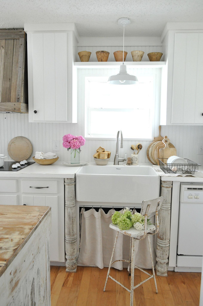Farmhouse kitchen with skirted farmhouse sink. We purchased the vintage wooden posts that anchor the sink, from a local antique shop. White Farmhouse kitchen with skirted farmhouse sink. Farmhouse kitchen with skirted farmhouse sink #Farmhousekitchen #skirtedsink #farmhousesink Home Bunch's Beautiful Homes of Instagram @becky.cunningham.home