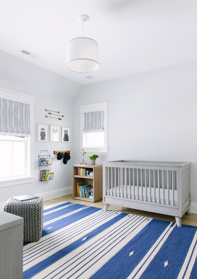 Grey nursery with striped rug. Nursery with striped rug. Pale grey nursery features a striped blue and white rug. Nursery with striped rug #Nursery #stripedrug Kate Marker Interiors