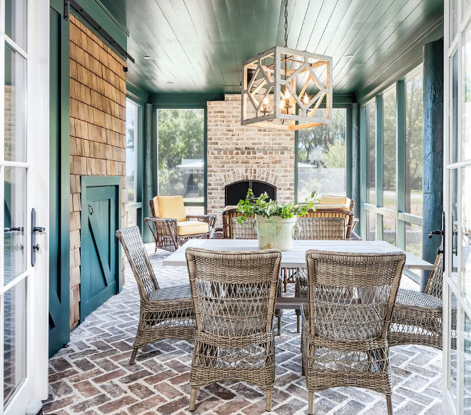 Herringbone brick flooring. Screened in patio with Herringbone brick flooring. French doors open to an inviting screened-in porch with herringbone brick. #Herringbonebrick #Herringbonebrickflooring Nancy Serafini Interior Design