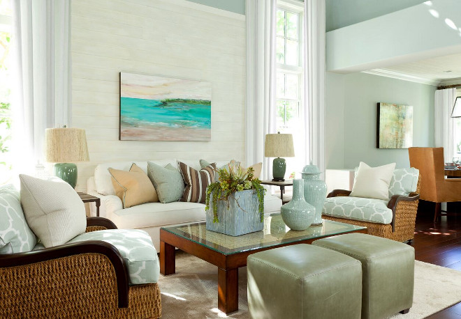 In the great room, because of the high ceilings, we added V Groove horizontal paneling and finished it in driftwood white to add a beachy, worn-over-time touch which made the room feel cozier. Barclay Butera