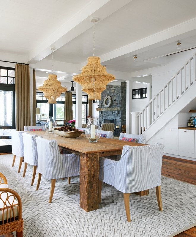 Jute twine chandelier. Coastal farmhouse dining room with Jute twine chandeliers. Coastal farmhouse dining room with two chandeliers and slipcovered dining chairs chairs. Jute twine chandelier. Jute twine chandelier #Jutetwinechandelier #Jutetwine #chandelier Jennifer Worts Design Inc