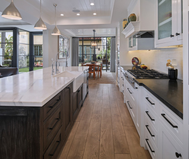 Kitchen Island and perimeter countertop ideas. The perimeter countertop is Hard Rock Granite with an honed finish and mitered edge. Classic combinataion of Island and perimeter countertop #Islandcountertop #perimetercountertop #countertopideas Patterson Custom Homes