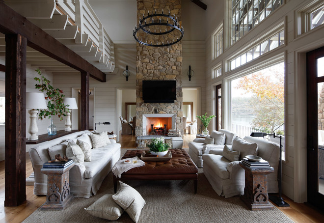 Lake House Interiors. Lake House Interiors. Lake house living room with high ceilings, shiplap walls, floor-to-ceiling stone fireplace and slipcovered furniture. Lake House Interiors. Lake House Interiors #LakeHouseInteriors #LakeHouse #Interiors Christopher Architecture & Interiors