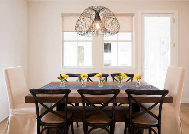 Modern Farmhouse Dining Area. Simple and skeek farmhouse dining area. I love the uncluttered feel of this dining area. This is especially good if you have small children - less clutter means more space for them to run around without getting hurt! Light fixture is Crate and Barrel #diningarea #modernfarmhouses Refined Custom Homes