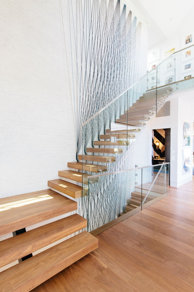 Modern Staircase with Glass rail on stainless steel stands offs with stainless steel cap. Modern Staircase with Glass rail on stainless steel stands offs with stainless steel cap #ModernStaircase #Glassrail #stainlesssteel