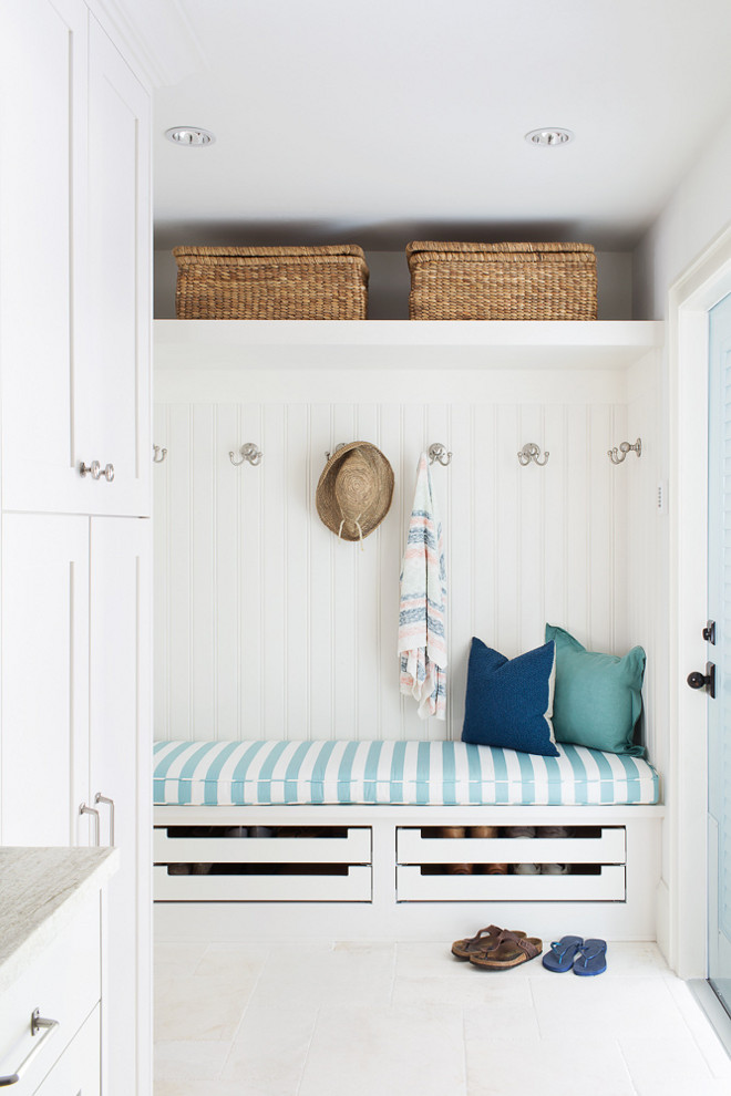 Mudroom Cubbies with beadboard paneling. Coastal mudroom with beadboard paneling and shoe drawers under built in bench. #mudroom #cubbies #beadboard #coastalmudroom #shoestorage #paneling Lischkoff Design Planning
