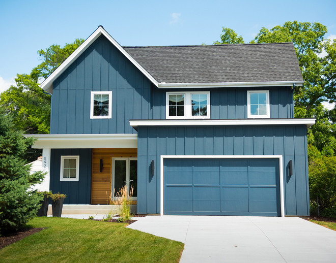 Navy Modern Farmhouse Exterior. The exterior also features board and batten and clear cedar lap siding. Navy Modern Farmhouse Exterior. Navy Modern Farmhouse Exterior #NavyModernFarmhouse #NavyModernFarmhouseExterior #ModernFarmhouseexterior #exterior Refined Custom Homes