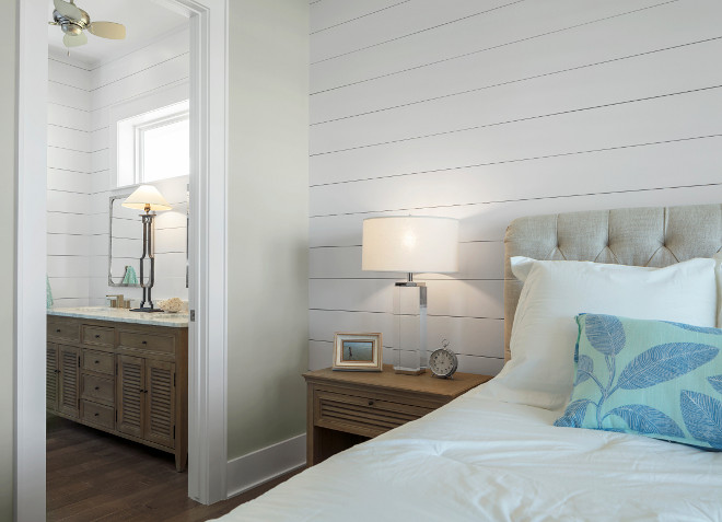 Neutral Coastal Farmhouse Bedroom and ensuite. The guest bedroom features shiplap and sheetrock walls. The sheettrock wall paint color is Sherwin Williams Agreeable Gray SW 7029.  Neutral Coastal Farmhouse Bedroom and ensuite. Neutral Coastal Farmhouse Bedroom and ensuite. Neutral Coastal Farmhouse Bedroom and ensuite #NeutralCoastalFarmhouseBedroom Julie Barrett Design