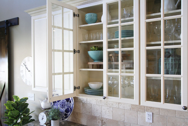 Off white kitchen cabinet with glass doors and rubbed oil bronze hardware. Hardware is Allen & Roth hardware from Lowes. Home Bunch's Beautiful Homes of Instagram @AshleysDecorSpace_