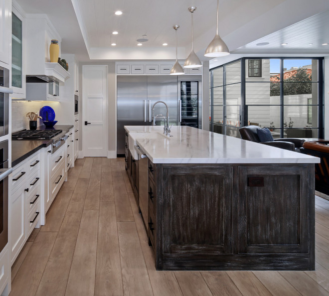 Pacific White Granite with an honed finish and mitered edge. Island Countertop is a white granite, Pacific White Granite with an honed finish and mitered edge #whitegranite #countertop #PacificWhiteGranite #honedgranite #miterededge Patterson Custom Homes