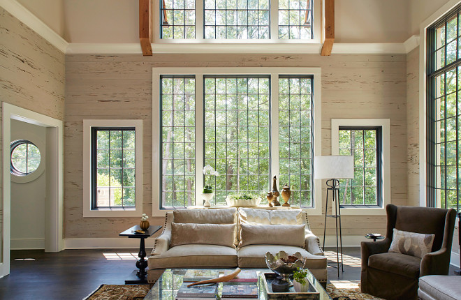 Pecky Cypress Shiplap. Neutral living room with Pecky Cypress shiplap and wall of windows. Living room Pecky Cypress Shiplap and black steel windows. Pecky Cypress Shiplap Pecky Cypress Shiplap #PeckyCypressShiplap #PeckyCypress #Shiplap #blackwindows #blacksteelwindows Christopher Architecture & Interiors