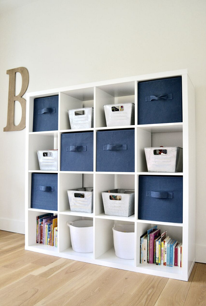 Playroom Storage Ideas. Bookcase is from Ikea. Blue and white Playroom Storage Ideas #blueandwhiteplayroom #playroom #storage #playroomstorage Home Bunch's Beautiful Homes of Instagram @sweetthreadsco
