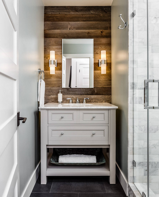 Rustic Bathroom with reclaimed shiplap.  The shiplap wood is Kentucky tobacco barn wood. Bathroom with reclaimed shiplap. Bathroom rustic wood shiplap wall and open vanity from pottery Barn. Floor tile is Basalt Tile #bathroom #rusticbathroom #reclaimedshiplap #rusticshiplap #bathroom #wood #barnwood Norwell Design Build