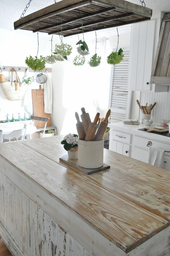 Shabby Chic Farmhouse Kitchen with distressed white island. The island is built from reclaimed wood. Shabby Chic Farmhouse Kitchen with distressed and whitewashed Kitchen island Home Bunch's Beautiful Homes of Instagram @becky.cunningham.home