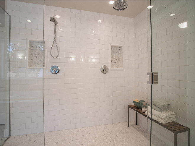 "Shower subway wall tile and hex marble floor tile. Shower features subway tile on walls and 1"" Hex Arabescato Carrara tile on floors and shower niche. Arabescato Carrara Honed 1"" Hex. Shower features white subway tile on walls and 1"" Hex Arabescato Carrara tile on floors and shower niche. #Shower #subwaywalltile #hex #marble #floortile Calista Interiors"