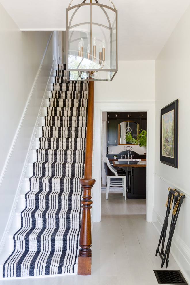 Striped stair runner. Stair runner is Dash & Albert. Striped stair runner. Stair runner is Dash & Albert. Farmhouse Striped stair runner. In the foyer a fun striped Dash and Albert runner was added to the staircase. The pattern is called Birmingham Black. Stair runner is Dash & Albert #Stripedstairrunner #Stairrunner #DashandAlbert Home Bunch's Beautiful Homes of Instagram Cynthia Weber Design @Cynthia_Weber_Design Photo by Robin Stubbert