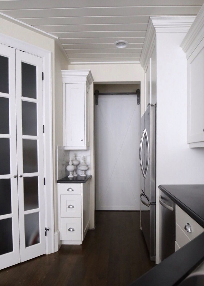 The pass through from the kitchen leads to our laundry. Adding a custom built barn door freed up space as one passes from kitchen to laundry. Home Bunch's Beautiful Homes of Instagram @cambridgehomecompany