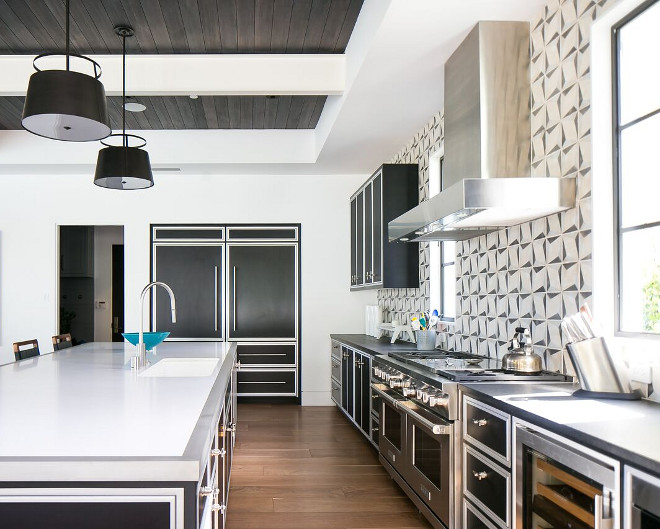 Transitional Kitchen Countertop. Kitchen Island Countertop: Brushed Finish Stainless Steel. Island countertop is white quartz with stainless steel trim. Perimeter countertop is leathered black granite. Patterson Custom Homes