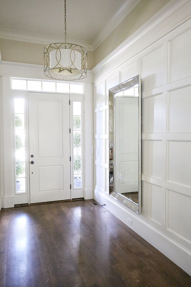Trimmed in wall paneling. Foyer Trimmed in wall paneling. Foyer Trimmed in wall paneling #Trimmedwallpaneling #Trimmedpaneling Home Bunch's Beautiful Homes of Instagram @cambridgehomecompany