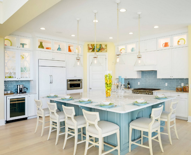 White Kitchen with Blue Backsplash Tile. This cheerful kitchen features crisp white cabinets, a blue island and a great layout! Notice the wet bar on the left. Coastal White Kitchen with Blue Backsplash Tile. White Kitchen with Blue Backsplash Tile Ideas #WhiteKitchenwithBlueBacksplash #WhiteKitchenwithBlueBacksplashTile Echelon Interiors