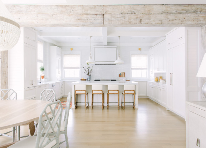 White Kitchen with Whitewashed Beams. This crisp white kitchen is anchored by custom whitewashed timbers. Crisp White Kitchen with Whitewashed Beams. White Kitchen with Whitewashed Beam ideas #WhiteKitchen #kitchen #whitewashedBeams Kate Marker Interiors
