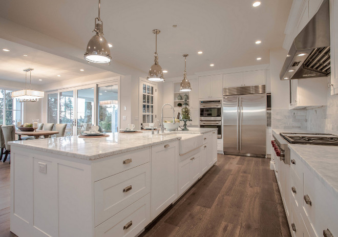 White Marble Island and White Marble Perimeter Countertop. This white kitchen features polished white marble countertop on the island and on the perimeter cabinets. The countertop is Carrara White Polished Marble from MSI. Polished White Marble Island and White Marble Perimeter Countertop. White Marble Island and White Marble Perimeter Countertop #WhiteMarbleIslandCountertop #WhiteMarblePerimeterCountertop #IslandCountertop #PerimeterCountertop Calista Interiors