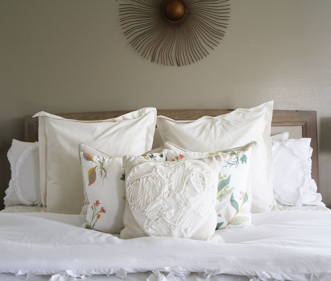 White bedding. I chose a white comforter in our master bedroom because I can easily incorporate color for any season and/or mood! Its easy to switch out a few pillows here and there to achieve the look I am going for that month or holiday. Right now it houses some beautiful embroidered pillow covers. Many have asked how and why I chose WHITE of all colors with toddlers. However it's not so bad and everything can be easily washed. All of our bedrooms are painted a soft grey. #Whitebedding #bedding Home Bunch's Beautiful Homes of Instagram @AshleysDecorSpace_