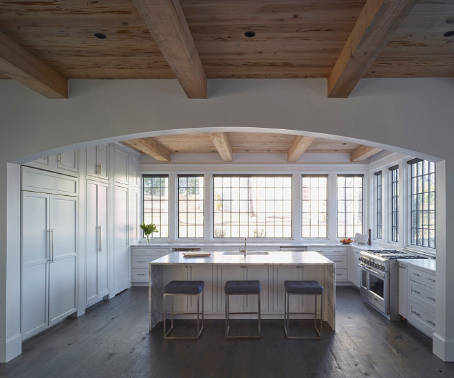 White kitchen with black steel windows, no upper cabinets and Pecky Cypress shiplap ceiling. White kitchen with black steel windows, no upper cabinets and Pecky Cypress shiplap ceiling #Whitekitchen #blacksteelwindows #nouppercabinets #PeckyCypress #shiplap #shiplapceiling