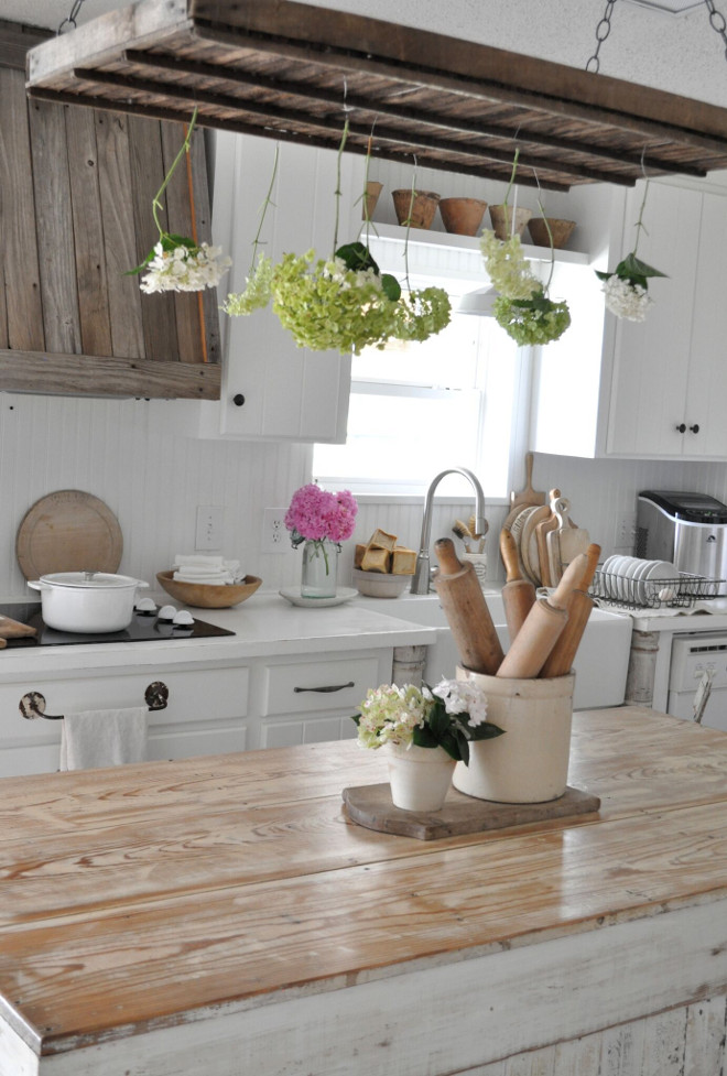 Whitewashed Kitchen Island. Distressed farmhouse kitchen with Whitewashed Kitchen Island. Whitewashed Kitchen Island #WhitewashedKitchenIsland #KitchenIsland Home Bunch's Beautiful Homes of Instagram @becky.cunningham.home