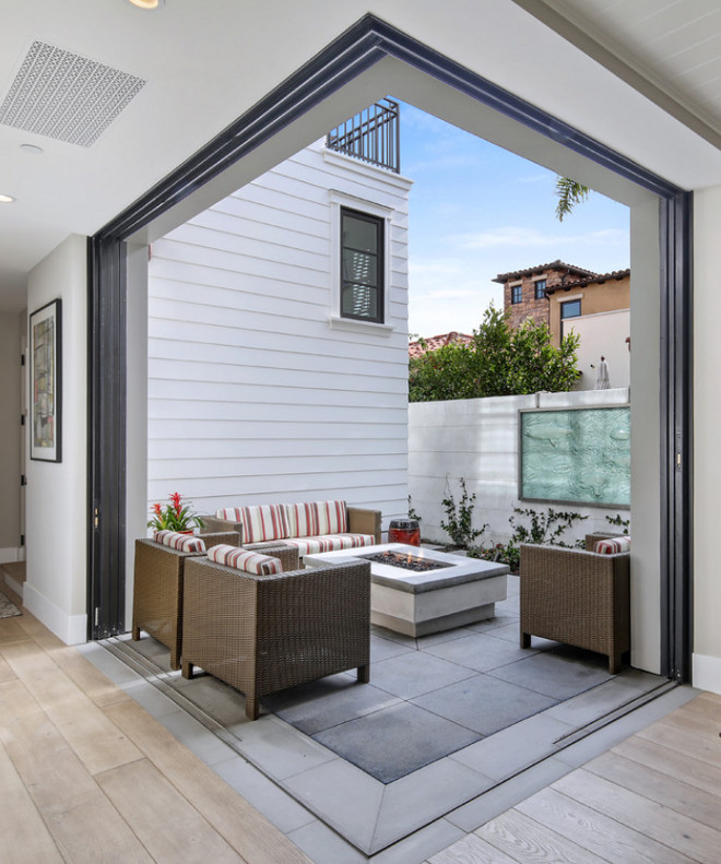 Steel door pocket sliders open up to the courtyard off of the great room creating an indoor/outdoor living space. The doors conceal inside the wall on both ends, enlarging the feel of the home. Patterson Custom Homes