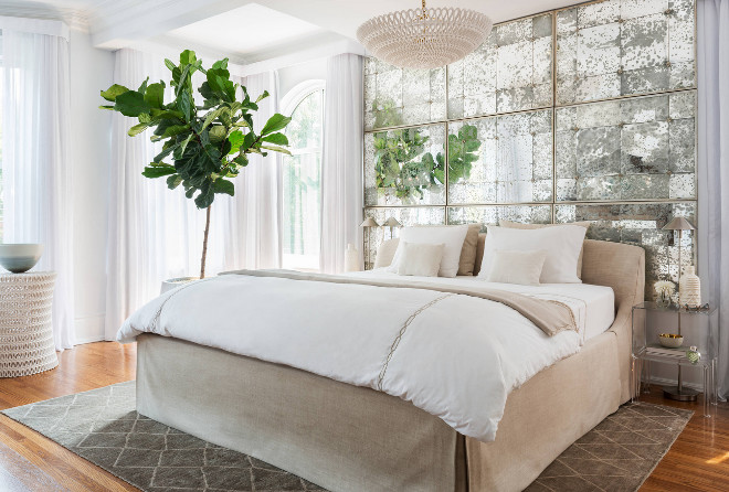 Bedroom Mirror. Bedroom antique mirror behind bed. The designer created this created this beautiful, reflective feature by mounting 9 of the same style of mirror, butted up against each other, to the wall behind the bed. #mirror #bedroom #bedrooms Toronto Interior Design Group | Yanic Simard