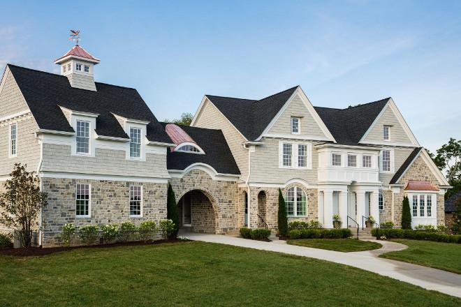 Classic shingle and stone home design. Artisan Signature Homes