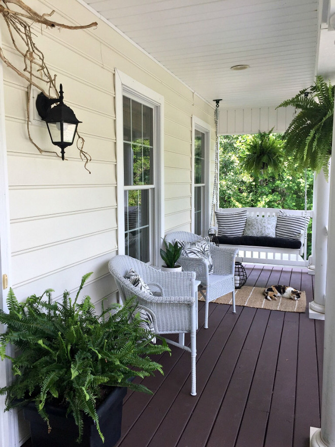 Front Porch. Front Porch stain is James T Davis solid stain in the color Tree Bark. The swing is from Hayneedle and the wicker conversation chairs are from Pier 1. Rugs are from Target. #frontporch #porch Beautiful Homes of Instagram @middlesisterdesign - Home Bunch