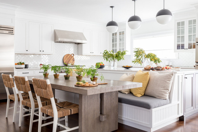 Kitchen island banquette. Farmhouse Kitchen island banquette. Sleek modern farmhouse white kitchen with large, custom island banquette. Farmhouse Kitchen island banquettedesign #FarmhouseKitchenisland #FarmhouseKitchenislandbanquette #islandbanquette Chango & Co.