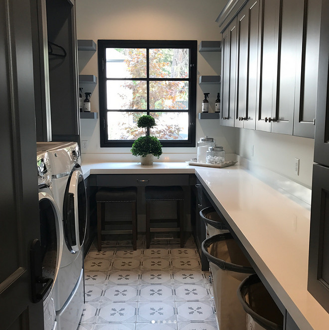 Laundry room with charcoal gray cabinets, white quartz countertop and black window. Laundry room with charcoal gray cabinets, white quartz countertop and black window. Laundry room with charcoal gray cabinets, white quartz countertop and black window. Laundry room with charcoal gray cabinets, white quartz countertop and black window #Laundryroom #charcoalgraycabinets #whitequartz #countertop #blackwindow Tree Haven Homes. Danielle Loryn Design