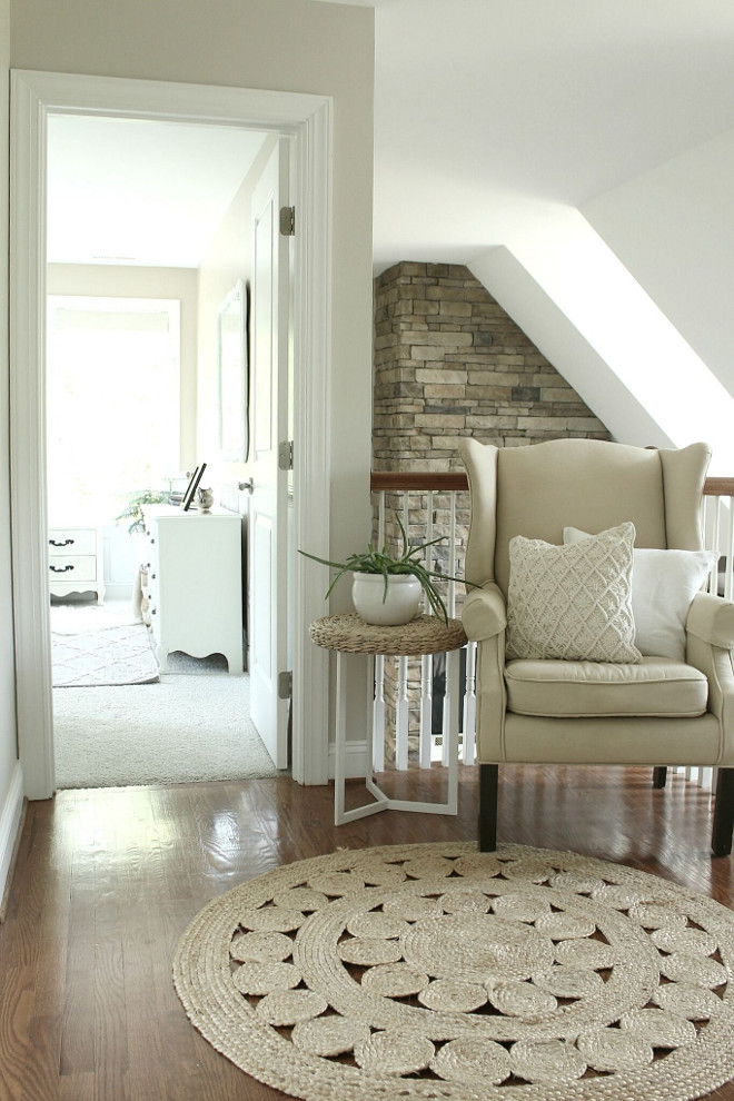 Neutral Landing area ideas. Neutral Landing area with chair, accent table and roud sisal rug. Neutral Landing area ideas #NeutralLanding Beautiful Homes of Instagram @middlesisterdesign - Home Bunch
