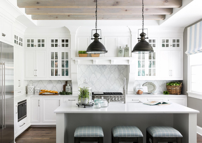 White farmhouse kitchen with bleached ceiling beams. White farmhouse kitchen with bleached ceiling beams. This white farmhouse kitchen features a pale gray kitchen and bleached ceiling beams. Beams are rough cedar and then white/grey washed. Backsplash tile is from Louisville tile. White farmhouse kitchen with bleached ceiling beams #Whitefarmhousekitchen #bleachedceilingbeams