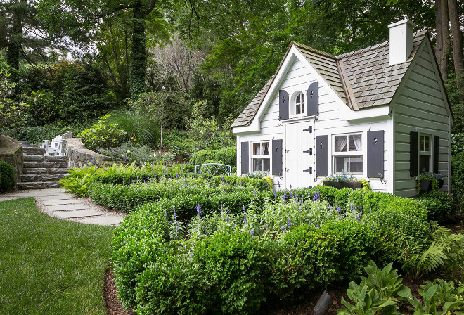 Garden Shed. Garden Shed with white siding and black shutters. Hobbs-Care