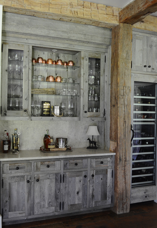 Barnwood bar. Rustic reclaimed wood bar cabinet. This custom designed bar is made from reclaimed barn wood. We also added a Thermador wine column with a reclaimed wood door panel. Rustic reclaimed wood bar cabinet. Rustic reclaimed wood bar cabinet. Rustic reclaimed wood bar cabinet #Rusticreclaimedwoodbarcabinet #Rusticreclaimedwood #barcabinet #Rusticr #eclaimedwood #bar #cabinet Beautiful Homes of Instagram @SanctuaryHomeDecor