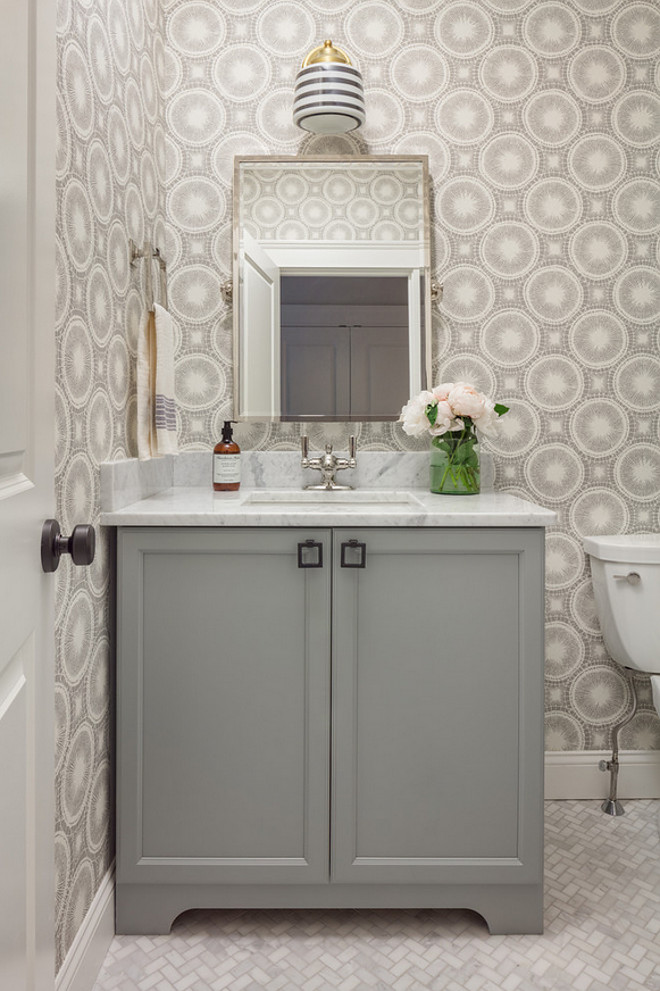 Bathroom Cabinet. Grey bathroom cabinet. Grey bathroom with white and grey wallpaper and herringbone marble floor tile. #BathroomCabinet #Greybathroom #bathroomcabinet #Greybathroom #whiteandgreywallpaper #herringbonemarblefloortile #herringbonefloortile #marblefloortile Jamie Keskin Design