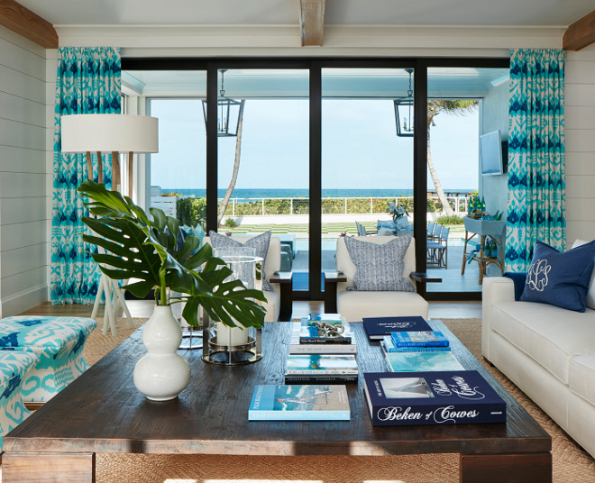 beach house living room with shiplap black steel folding patio doors and blue white