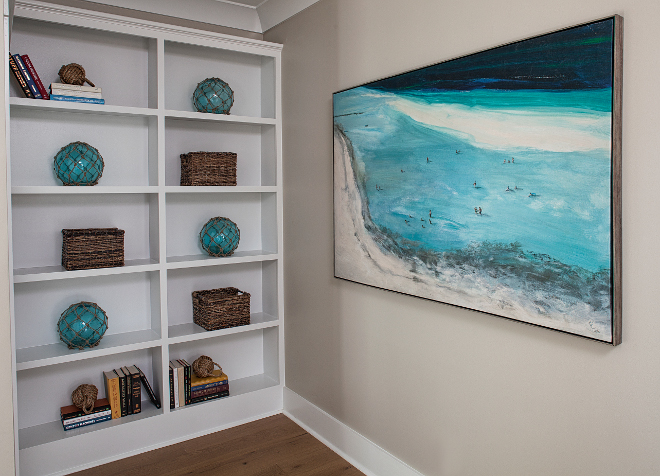 Bookcase Coastal Decor and Coastal Art. Wall Paint color is Benjamin Moore HC-172 Revere Pewter and bookcases are painted in Sherwin Williams Pure White. Lisa Furey - Barefoot Interiors