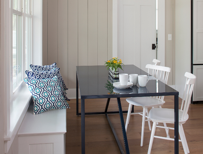 Breakfast Nook Banquette. Simple breakfast nook with built in banquette, hardwood floors and vertical shiplap painted in a neutral creamy color, Sherwin Williams Only Natural #breakfastnook #sherwinwilliamsonlynatural #shiplap #hardwoodfloors #verticalshiplap #banquette Lisa Furey - Barefoot Interiors