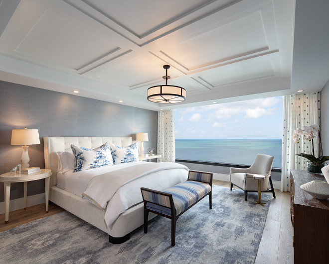 Condo Bedroom. Condo Bedroom. Soft, serene and peaceful with a stunning view of the Gulf. Condo Bedroom. Wallcovering: Manilla Hemp in Cloudless from Phillip Jeffries. - Rug: The Rug Company. - Traversing Drapery Side Panels are custom in Designer's Guild fabric. #CondoBedroom #Bedroom W Design