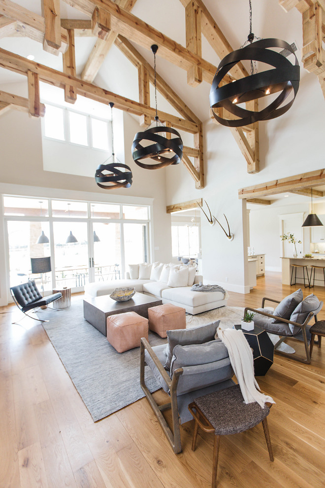 Exposed beams. Exposed beams. Beams were kept natural to match the hardwood floors. Living room Exposed beams #Exposedbeams Urbanology Designs