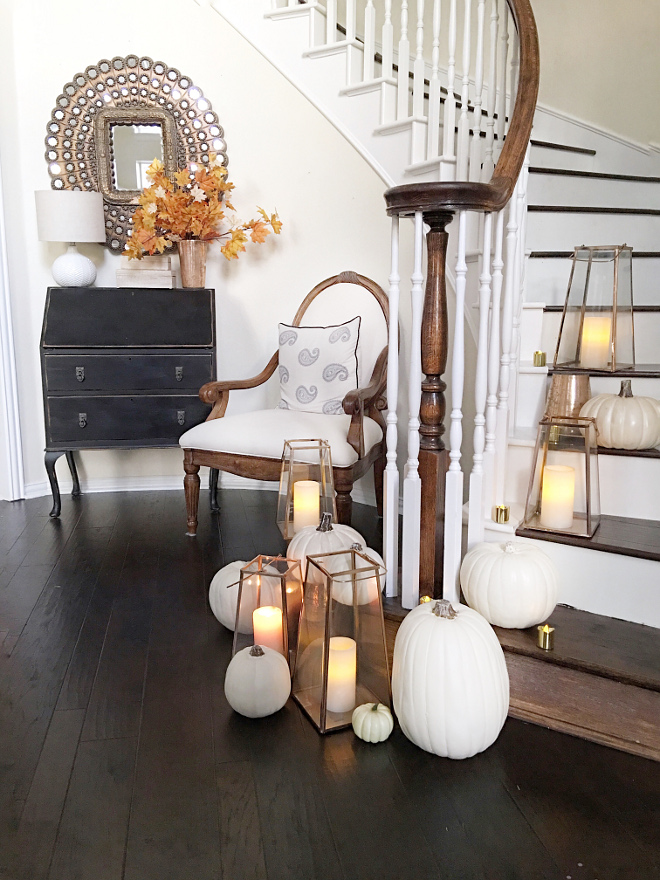 Fall Foyer Decor. Fall lanterns and white pumpkins foyer decorating ideas #falldecor #foyerfalldecor #foyer #lanters #whitepumpkins @thriftyniftynest