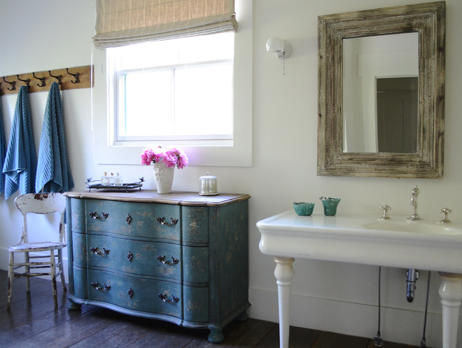 Farmhouse Bathroom. Farmhouse Bathroom. We love the vintage sink and oversized bathtub and only added the chest of drawers under the sink for storage. Farmhouse Bathroom. Farmhouse Bathroom #FarmhouseBathroom Beautiful Homes of Instagram @SanctuaryHomeDecor